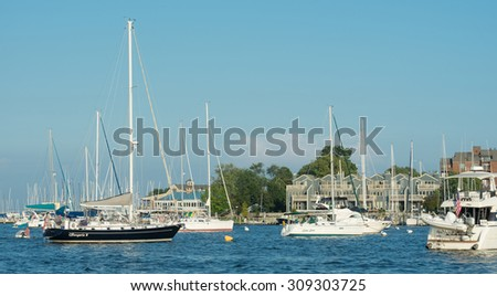 ANNAPOLIS, MARYLAND - JULY 18: Sailboats in the Chesapeake Bay as viewed from the city dock on July 18, 2015 in Annapolis, Maryland  - stock photo