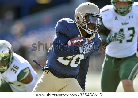 ANNAPOLIS, MD - OCTOBER 31: Navy Midshipmen running back Calvin Cass Jr. (20) carries the ball during the AAC game October 31, 2015 in Annapolis, MD.