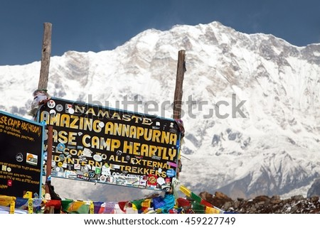 ANNAPURNA BASE CAMP, NEPAL, 12th APRIL 2016 - Mount Annapurna and Signboard in base camp, round Annapurna circuit trekking trail, Nepal