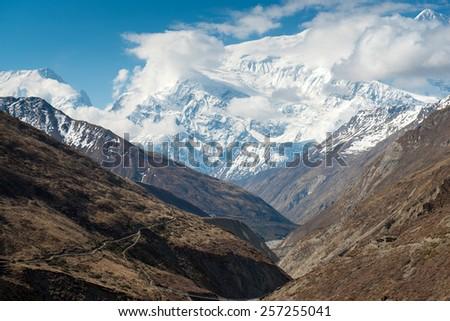 Annapurna Circuit - most popular tourists trek in Himalayan mountain massive in Nepal. - stock photo