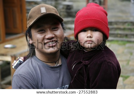 ANNAPURNA, NEPAL – APRIL 3: A young Nepali trekker guide enjoys mixing with his Gurung ethnic group in Annapurna, Nepal April 3, 2008. Annapurna trail is well known for its trekking activities.