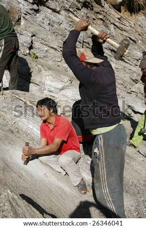 ANNAPURNA, NEPAL - MARCH 19 : Road construction workers prepare for dynamiting on March 19, 2008 in Annapurna, Nepal. The Annapurna is the tenth highest mountain in the world.