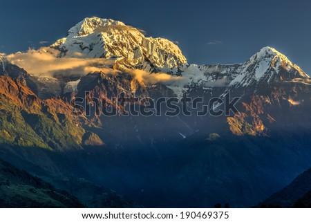 Annapurna South mountain peak at sunrise in Himalayas, Nepal - stock photo