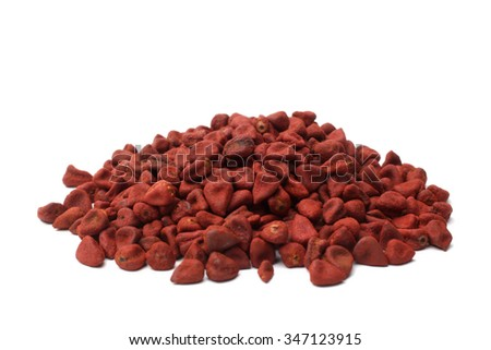 Annatto seeds on white background - stock photo
