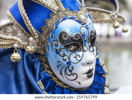 ANNECY,FRANCE- FEB 23:Portrait of an unidentified person disguised posing in Annecy,France,on February 23 2013.Every year here is held a Venetian Carnival to celebrate the beauty of real Venice - stock photo
