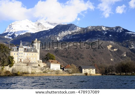 Annecy Lake landscape, castle and mountains from boat, in Savoy, France