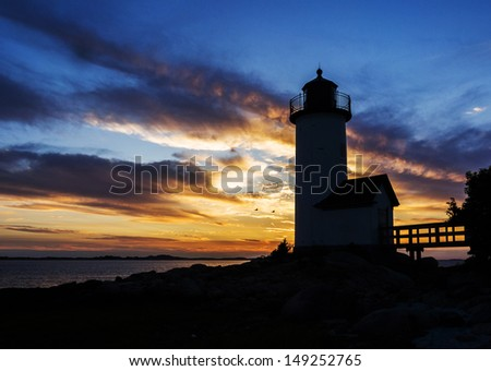 Annisquam lighthouse at sunset off the coast of Gloucester, MA. USA