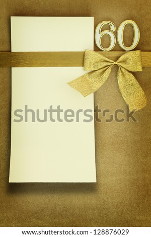 Anniversary card on golden background - stock photo
