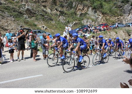 ANNONAY, FRANCE - JULY 13: Young racing cyclists ride before stage 12 of Le Tour de France 2012. David Millar wins the race on July 13, 2012 in Annonay Ardeche, France. - stock photo