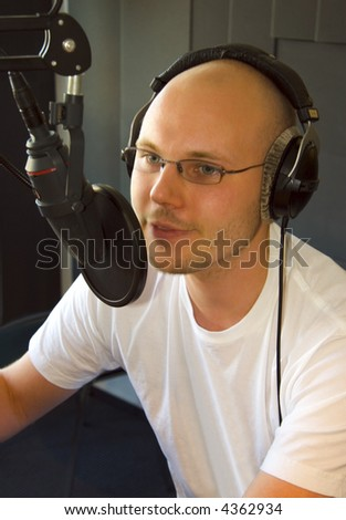 Announcer and dj at broadcasting station - stock photo