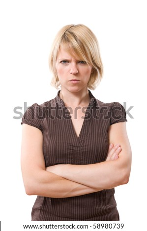 annoyed blond woman with crossed arms isolated on white - stock photo