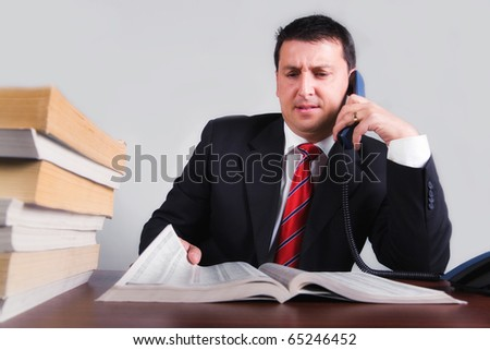 Annoyed business man calling from list
