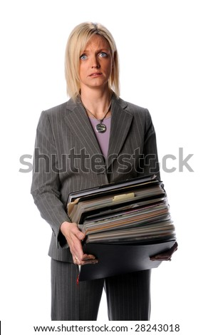 Annoyed businesswoman holding large stack of files