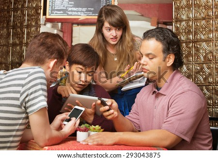 Annoyed cafe hostess annoyed with distracted customers - stock photo