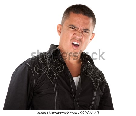 Annoyed middle-aged Hispanic man on white background