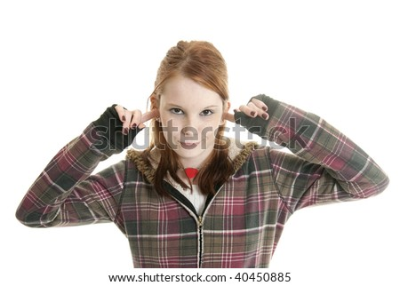 Annoyed teenage girl with her fingers in her ears - stock photo