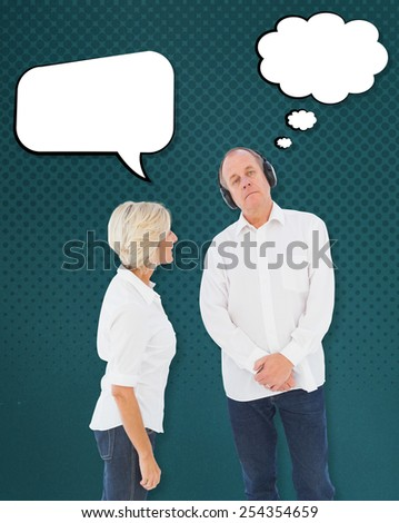 Annoyed woman being ignored by her partner against teal - stock photo
