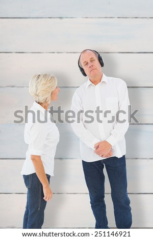 Annoyed woman being ignored by her partner against wooden planks - stock photo