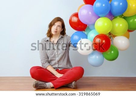 Annoyed Woman Holding Balloons