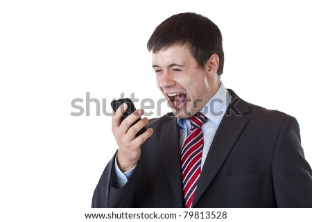 Annoyed young businessman shouts aloud in cell phone.Isolated on white background. - stock photo