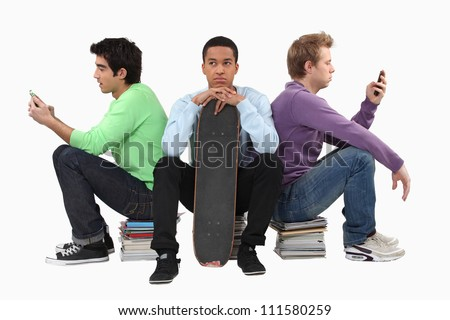 Annoyed young man waiting for his friends to finish texting - stock photo