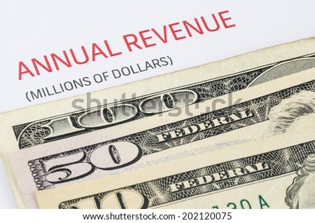 Annual Revenue report with US banknote