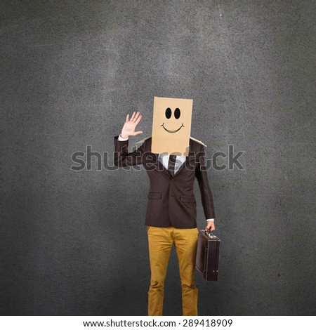 Anonymous businessman against grey room - stock photo