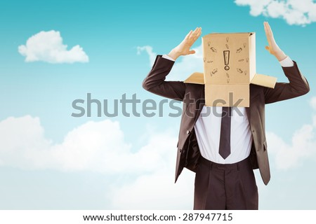 Anonymous businessman gesturing with hands against blue sky - stock photo