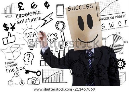 Anonymous businessman is writing success concept on transparent whiteboard - stock photo