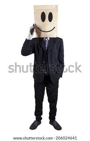 Anonymous businessman talking on the phone, isolated on white - stock photo