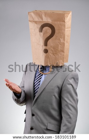 Anonymous businessman wearing a paper bag on his head with a question mark concept for  business recruitment, mystery shopper, failure or embarrassment - stock photo