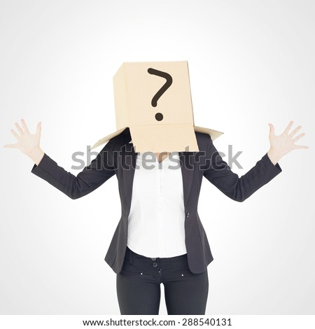 Anonymous businesswoman with her hands up against white background with vignette - stock photo