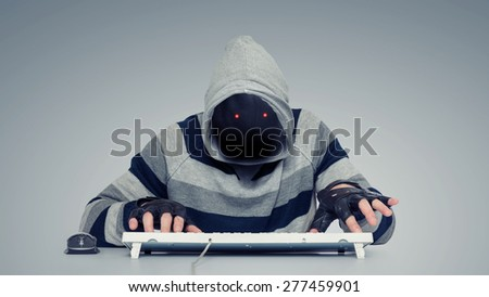 Anonymous hackers on the computer - stock photo