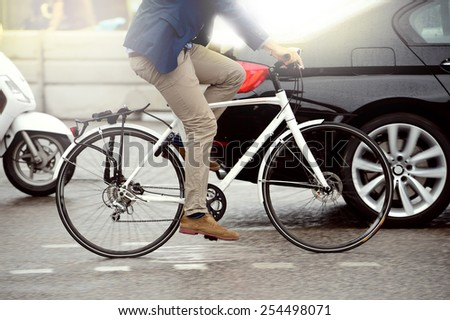 Anonymous person on bike - stock photo