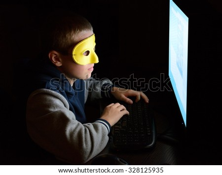 anonymous user looking at the screen - stock photo