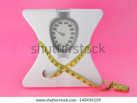 anorexia concept with scale and measuring tape - stock photo