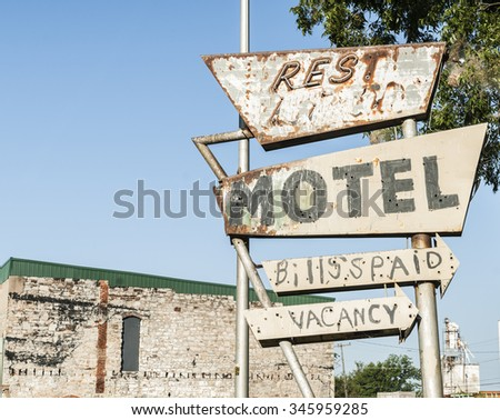 Another abandoned motel sign, peeling paint and rust removed the name. Oklahoma on Route 66, USA - stock photo