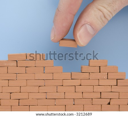 another brick on the wall - stock photo