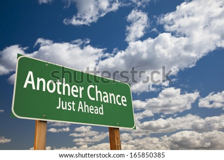 Another Chance Just Ahead Green Road Sign Over Dramatic Clouds and Sky. - stock photo
