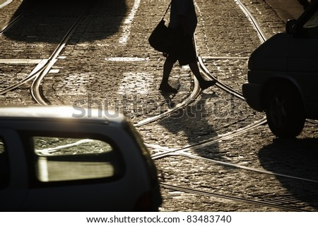 Another tropical day is beginning.  People are walking across crosswalk and weather will bring temperature over 30 degrees on August 26, 2011 in Prague. - stock photo