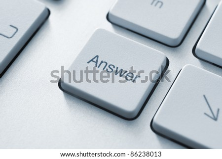 Answer button on the keyboard. Toned Image. - stock photo