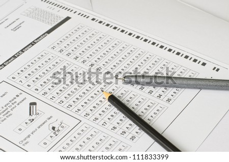 Answer Sheet and pencil - stock photo