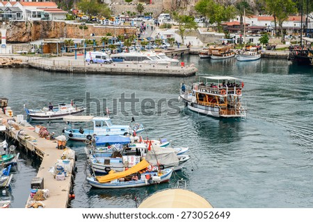 ANTALYA, TURKEY - APR 19, 2015: Ships in the old harbour in Antalya (Kaleici), Turkey. Old town of Antalya is a popular destination among  tourists
