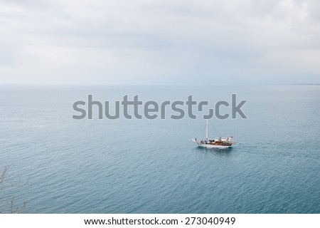 ANTALYA, TURKEY - APR 19, 2015: Touristic yacht on the Mediterranean sea near the Old harbour in Antalya (Kaleici), Turkey.  Mediterranean sea is 2,500,000 km2