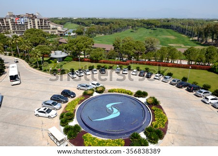 ANTALYA, TURKEY - APRIL 22: The parking place near Calista luxury resort on April 22, 2014 in Antalya, Turkey. More then 36 mln tourists have visited Turkey in year 2014. - stock photo