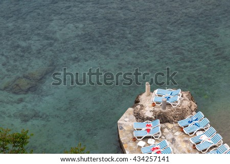 ANTALYA, TURKEY - APRIL 24, 2016 : Top view of seascape on mediterranean sea with sunbeds on the coast. - stock photo
