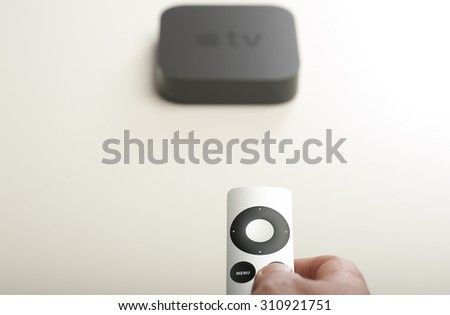 ANTALYA, TURKEY - AUGUST 28, 2015: A man remotely controlling his Apple TV device