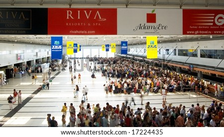 ANTALYA, TURKEY - AUGUST 20: Passengers await check in on August 20, 2008 at Antalya International Airport Terminal 2, Turkey. - stock photo