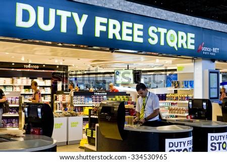 ANTALYA, TURKEY - JUNE 8, 2011: People seen at a Duty free shop at Antalay International Airport. - stock photo