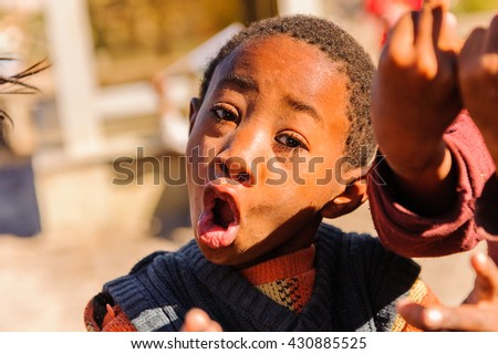 ANTANANARIVO, MADAGASCAR - JUNE 27, 2011: Unidentified Madagascar man smiles and poses for camera. People in Madagascar suffer of poverty due to the slow development of the country - stock photo